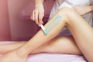 Women Having Her Legs Waxed